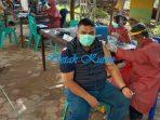 Hepni Armansyah Ikut Vaksin Bersama Masyarakat di Pasar Induk Sangatta